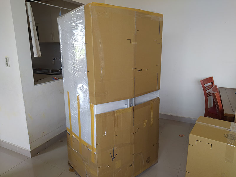 bao bọc tủ lạnh bằng bìa carton
